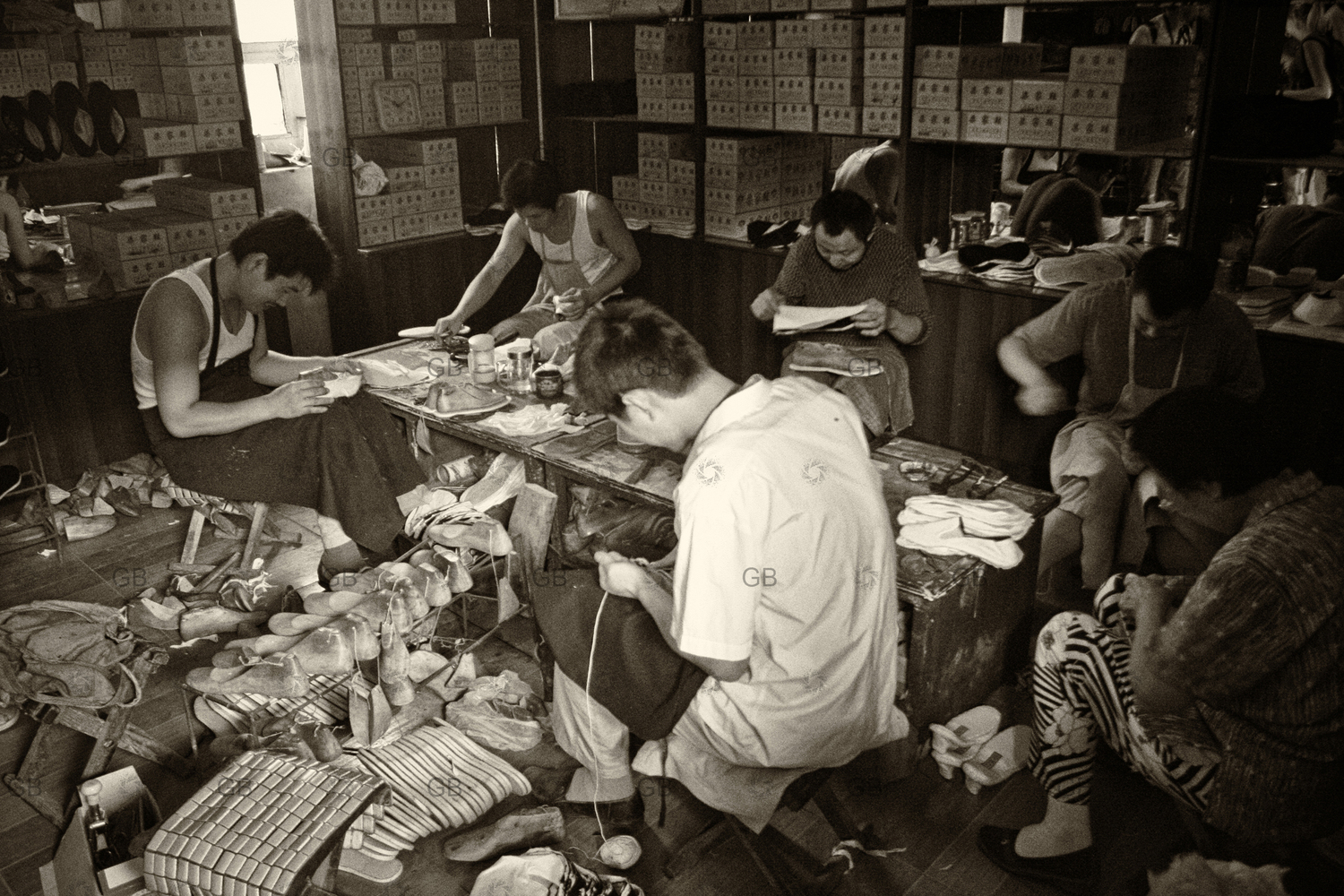 Worker making shoes in China